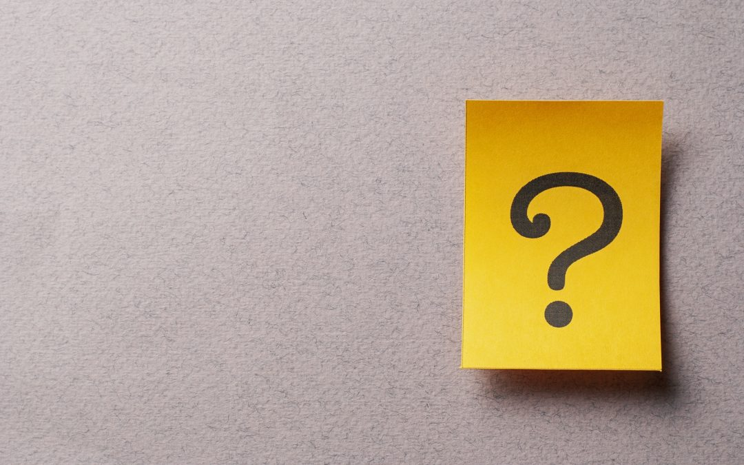 Colorful yellow card with printed question mark
